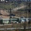 مئات من مقاتلي المعارضة وأسرهم يغادرون ضاحية محاصرة في دمشق